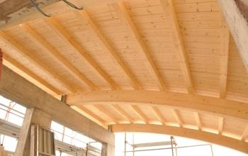 Copertura sagomata curva con verande laterali